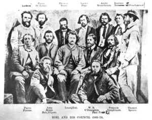 Louis Riel's Provisional Government 2nd row, 3rd from left, Louis Riel Back row, 3rd from left, Thomas Bunn [click to enlarge]