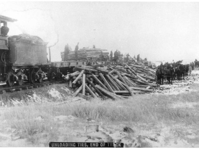 Unloading railway ties, 1882.