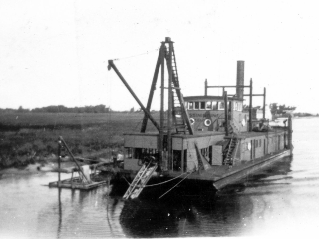 Government dredge at mouth of Red River, 1924