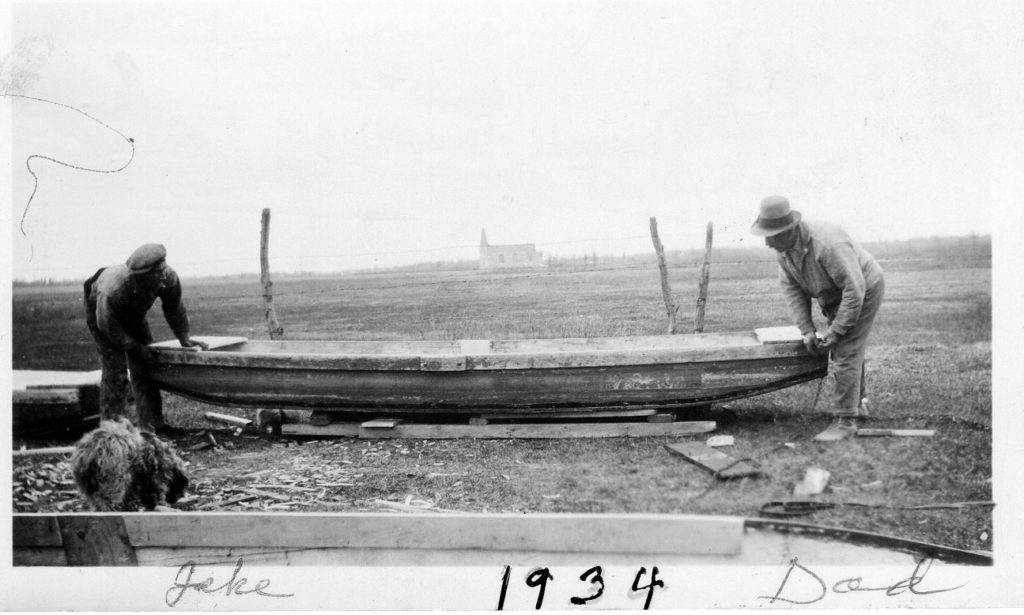 Dad and Jake Donald repairing boats 1934