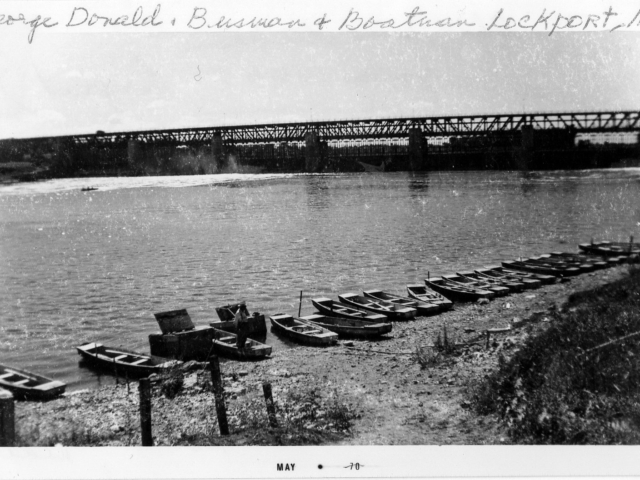 1940 George Donald's boat livery while the bridge was being built. Before the bridge was built George transported people across the river