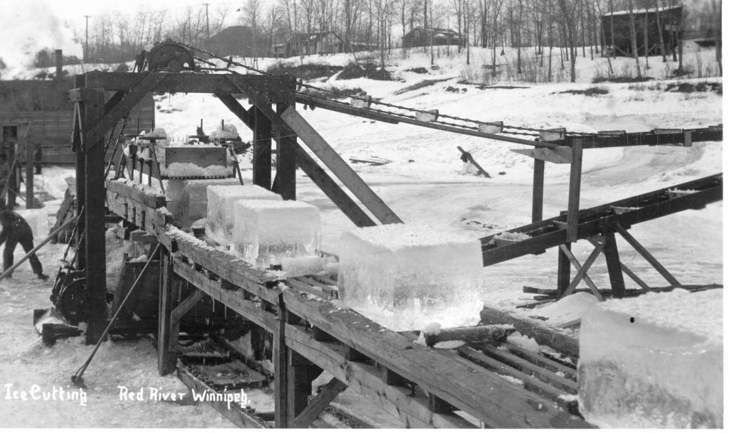 Cutting ice on Red River , c1915