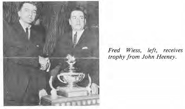 Fred Wiess receives trophy from John Heeney