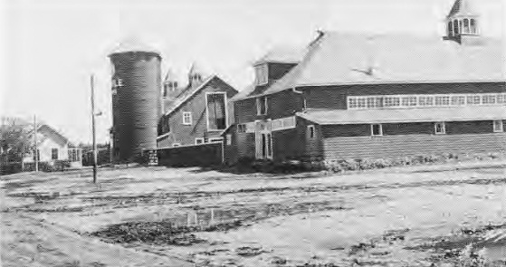 Hog barn, extreme right, Milk house, beef barn and silo, 1941