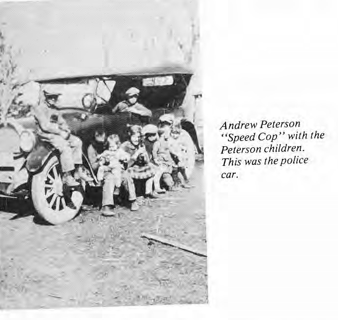 Andrew Peterson with his children and police car