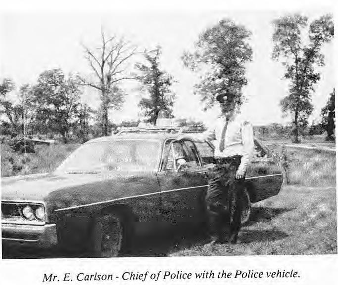 E. Carlson with Police Car