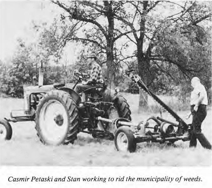 Casmir Petaski and Stan working to get rid of weeds