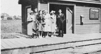 Waiting for the Train to Grand Beach, 1939. Left to Right: Mrs. Stina Johansson, Lena Pruden, Stella Pruden, Osk Johanasson, Sophie Marko with Anne and Johnnie Marko behind.