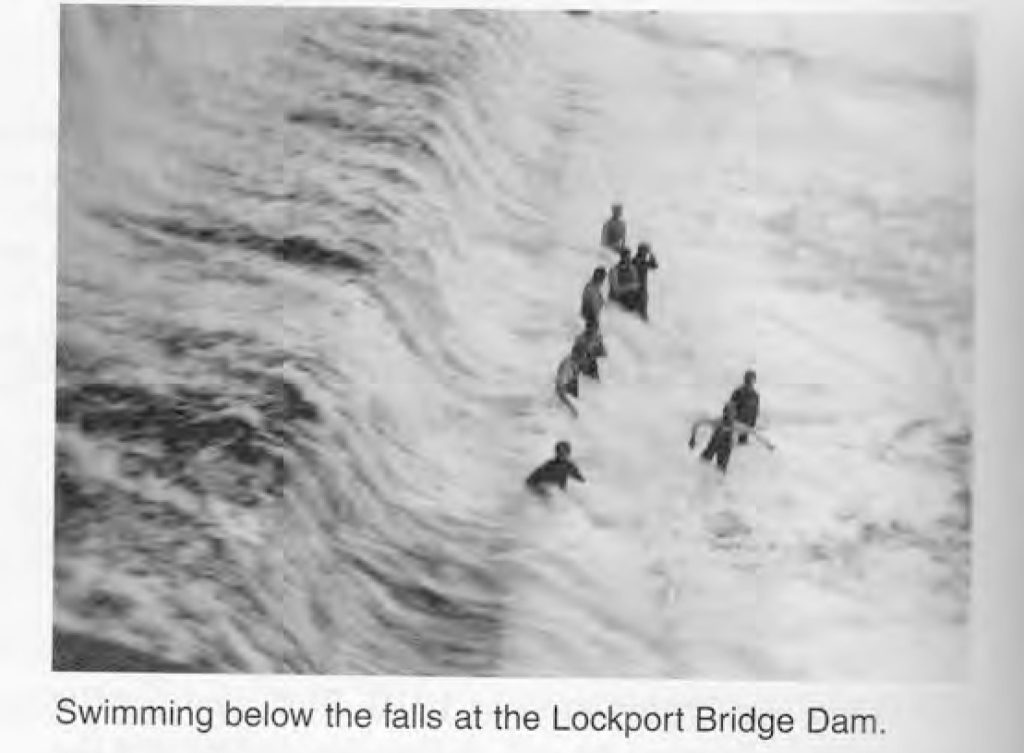 Swimming below the falls at Lockport Bridge and Dam